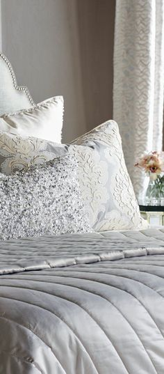 Supple fabrics, jewel beaded features, and surprising designs have added to the innate charm of satin textures gloriously showcase cosmopolitan designs such as a bold, sequin bolster and decorative shams that inspire an opulently glam nature. #bedding #luxurybedding #designerbedding #bedroomideas #decoratingideas #masterbedroom #duvetcovers #comforters #luxe #glamorous
