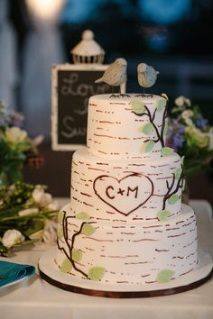 If you've ever carved you and your significant other's initials into a tree, this rustic wedding cake will bring back that memory! The bird cake toppers finish it with a sweet accent. {By Mille B Photography}