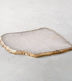 Encircled by an elegant 24K gold trim, each of these platters is as unique as it is beautiful. Due to the organic nature of the stone, no two pieces are exactly the same.