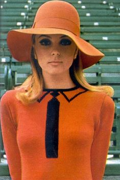 orange fashion. Undated, but I'm guessing late 60s/poss early 70s (makeup more 60s; but the beginning of the floppy brim says 70s hat to me)