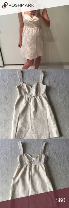 Cream and gold Guess dress Cream and gold Guess dress. Gently used in good condition. No trades. Please ask all questions before purchasing and use the offer button, thanks! Guess Dresses