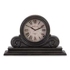 "Victorian Black Mantle Clock With Victorian elements, the Black Windsor mantel clock features a stately shape and a face of Roman numerals adding an heir of sophistication. Measures: 12""h x 19""w x 5""d"
