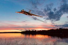 Art prints about A huge Avro Vulcan delta wing bomber makes a low level pass over an English lake at sunset. Avro Vulcan, Delta Wing, Airplane Photography, Canvas Prints, Art Prints, Art Cars, Britain, Aviation, Mountains