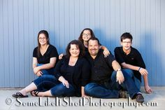 family photos blue gray fence La Jolla CA by www.SomeLikeItShotPhotography.com