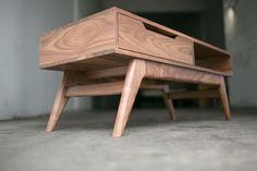 Sleek and USA-made. Danish Modern Mid Century Inspired Walnut Coffee Table. $825.00, via Etsy.