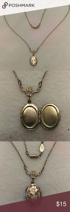 Vintage locket necklace Beautiful silver rare locket with room for two photos or keepsakes. Has a Twist together enclosure. unknown Jewelry Necklaces