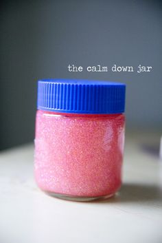 the calm down jar -- plastic jar, tacky glue, food color, glitter -- 1 tablespoon of pink glitter-glue with about 1 cup of hot water, then added pink food colouring and a tiny tub of glitter. The glue makes the water so thick and gooey that the glitter just slowly and gently swirls around, it takes about 5 minutes for all the glitter to settle, perfect to gather your thoughts!
