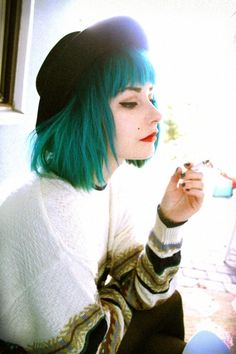 blue hair and awesome sweater.