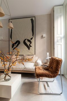 This chic apartment in Madrid looks so soft and cozy thanks to several shades of beige applied in the design. A large abstract painting above the sofa, ✌Pufikhomes - source of home inspiration Home Living Room, Living Room Decor, Living Spaces, Living Room Interior, Cozy Living Rooms, Home Interior Design, Interior Architecture, Interior Decorating, Home Design Decor