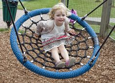 The park in Manitou has swings like this and they are SO FUN!  I have been searching for a place to buy them from, I would definitely install a couple in my yard.