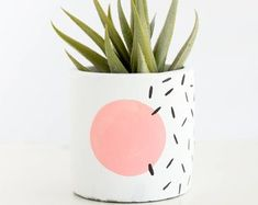 s Style Memphis design small planter for succulent or cactus modern abstract geometric Long live the in these hand painted modern geometric planters based off of Memphis design style Each planter will have a white base and a color. Painted Plant Pots, Painted Flower Pots, Memphis Design, Cement Planters, Diy Planters, Succulent Planters, Concrete Planters, Garden Planters, Succulents Garden