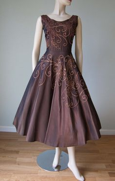 Emma Domb label  From the early 1950s - the color is mauve, a purple-ish brown  * made of rayon taffeta with an iridescent color quality  *