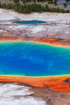 """It looks red hot, yet--silly me--I still want to junp in (I guess because it's such a """"cool"""" place!)  Wyoming: Grand Prismatic Spring, Yellowstone National Park."""