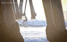 Late afternoon surfing at the Huntington Beach pier in Orange County, California.
