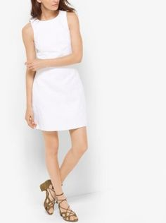 This effortless LWD is tailored in cotton-blend with a tactile jacquard weave. Fastened by an exposed gold-tone zipper, this warm-weather classic will look chic from AM to PM with strappy heels and sleek jewelry.