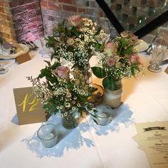 Table centre-piece at Shustoke Farm Barn #weddingstylist #eventflowers #prophire #centrepiece #warwickshireflorist #birminghamflorist #lanterns #candlearbra #vasedisplay #jarsflowers #logslice #mirrorbase #t-lights #martinvase #flutedvase #champagnevase #jugofflowers #vintagebottles #flowersinpumkin #moss #wildflowers #pennyjohnsonflowers #shustokefarmbarn