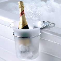 This is the bucket chiller that clamps to the side of a bathtub and keeps champagne or wine on ice while you bathe. The frosted acrylic bucket holds a full size champagne or wine bottle and helps keep it cold and within reach as you relax or celebrate. Just In Case, Just For You, Wine Caddy, Ideas Prácticas, Gift Ideas, Wine Chiller, Wine Cellars, Hammacher Schlemmer, Jacuzzi Tub