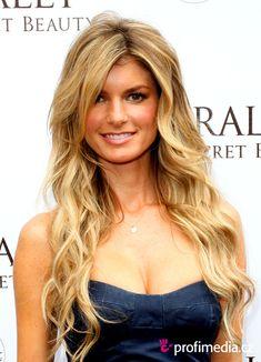 Love her! Long layered hair. Waves. No bangs.