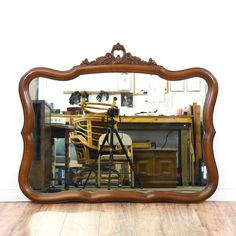 This Victorian style mirror is featured in a solid wood with a glossy cherry finish. This accent mirror has curved trim edges and a carved top with floral accents. Eye catching piece perfect for a bathroom vanity wall! #americantraditional #decor #mirror #sandiegovintage #vintagefurniture