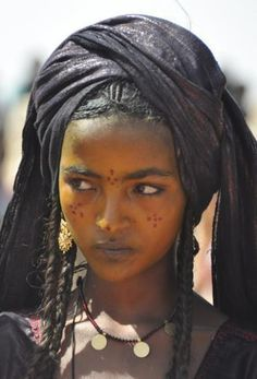 A Tuareg Girl:  The Tuareg are a Berber people with a traditionally nomadic pastoralist lifestyle.  Most Tuareg live in the Saharan parts of Niger and Mali but, being nomadic, there is constant movement across national borders, and small groups of Tuareg are also found in southeastern Algeria, southwestern Libya and northern Burkina Faso, and a small community in northern Nigeria.