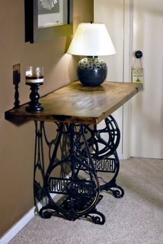 Table made out of an old cast iron sewing machine base and a work bench top foter.com