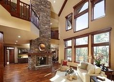 4 Peaceful Clever Ideas: Interior Painting Trends interior painting tips profess… – Stone fireplace living room Stone Fireplace Surround, Fireplace Design, Basement Fireplace, Stone Fireplaces, Wood Fireplace, Fireplace Ideas, Stained Wood Trim, High Ceiling Living Room, Traditional Family Rooms