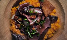 Nigel Slater's mushroom 'bourguignon' recipe on a round wooden plate
