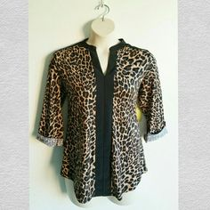NEW Leopard Blouse 3/4 Sleeve L New Size L Runs big  Estimate for XL, 1X  Color black, brown Stretches Not see through V-neck line 3/4 Sleeve  Great condition  No flaws Tops Blouses