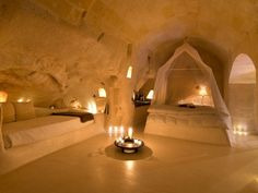 Matera, Italy Have you ever dreamed of spending the night in a cave? I hadn't either, until I came across the Hotel Sant'Angelo Sassi. Forget about night spent in dark, creepy corners—you'll  be greeted here by opulent canopy beds, cozy candlelight, and oversize bathtubs. In short, it's a perfect hideaway for relaxing or romancing on your next getaway.