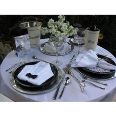 dinner for 2. love the black and white and napkin fold! Great for a black tie event