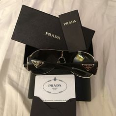 Authentic Prada Sunglasses In excellent condition. No scratches. Rarely worn. Comes with original sunglass case, the cloth to clean the sunglasses, the box the case came in, and the authenticity certificate card. Make me an offer! Prada Accessories Sunglasses