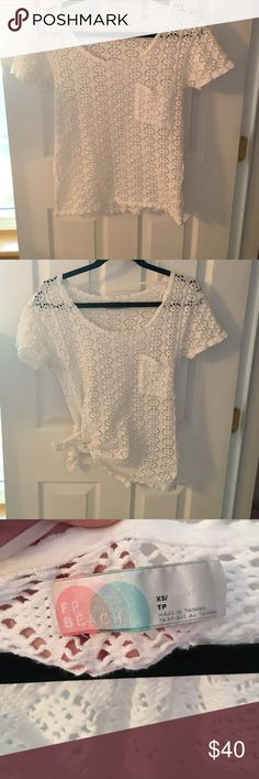 SPRING BREAK READY! Free People Crochet Top Free People Beach Crochet cover-up top. It has beautiful sun dial designs cut into it, and slits on both sides so it can be tied. Has a pocket in the front, and is in great condition. I've work it as both a shirt with a bandeau under it and a cover up for the beach/pool. Perfect for your upcoming spring break trip :) Free People Tops Tees - Short Sleeve