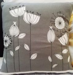 Appliqued cushion with machine embroidery