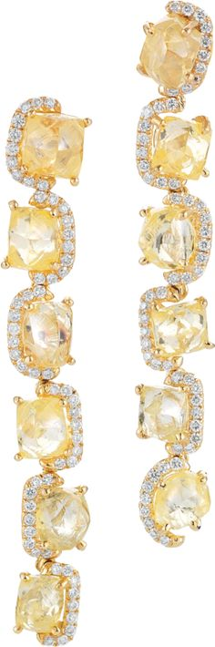 Luxury diamond line earrings featuring 10.08cts of rough diamonds accented with 0.49cts of micro pave in yellow gold.