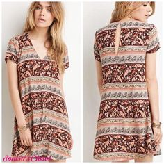 Floral boho dress Brown neutral colors with paisley and floral print adorn this lightweight button up dress. Short sleeves. Lightweight flowy rayon material. 🚫no trades. Stock photos from Forever21.com. Forever 21 Dresses