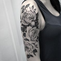 Black and grey rose tattoo by Elisabeth Markov. Rose tattoos are one of the most sought after tattoos in the world and has always been a classic symbol of beauty, balance and love. Enjoy!