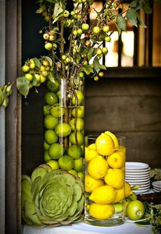lemon & limes in hurricanes with branches or flowers...easy fresh look, so pretty!