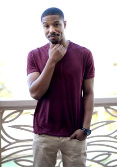 Pin for Later: 22 Michael B. Jordan Photos That Will Make You Feel All Tingly Inside  Michael struck a shy-guy pose at the Dubai International Film Festival in December 2013.