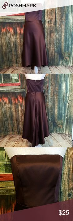 Simple but Elegant strapless dress This simple but Elegant dress is brown and in great shape.  Has a zipper which works great and is 14 inches long.    Armpit to armpit is 16 inches laying flat  Waist width is 14 1/2 inches laying flat  Dress length is 36 1/2 inches long measuring from the front and 39 inches from the back to the longest point.  Please let me know if you have any questions  Accepting offers and bundle discounts Cache Dresses