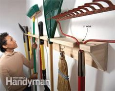 Create a simple long-handled tool hanger out of two 1x4s. On the first one, drill a series of 2-in. holes along the edge of the board. The t...
