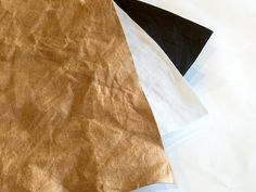 Introducing Silhouette's faux leather paper has fabric-like qualities and feels similar to leather, but it is actually paper. It can be sewn onto projects and washed. coming summer 2015