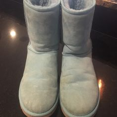 The Classic Short Ugg The classic short ugg is an icon of casual style. This soft baby blue boot looks amazing with anything to add a little style to your outfit and stay warm. Front of boots shows slight wear.  Picture shows the wear UGG Shoes Ankle Boots & Booties