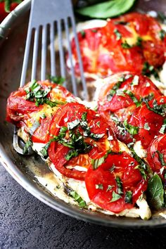Caprese Skillet Chicken Recipe - Pan-seared chicken topped with melting mozzarella cheese, fresh tomatoes, a sprinkle of basil, and a drizzle of balsamic vinegar. Quick, easy, and SO delicious!