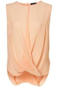 Love the color and the style of this blouse. Would be great with a cardi or blazer