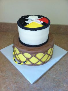 A very cool & unique wedding cake. A Native American drum & symbolic colors on top.