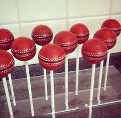 Wow! Cricket ball cake pops by Definitely Cake!