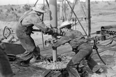 Adding a length of drilling pipe at oil well in Seminole oil field, Oklahoma.  Wrenches applied to loosen pipe, 1939