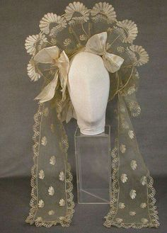 wedding bonnet 1820-1825 of silk net and blond lace. Hampshire County Council Arts and Museum Services.