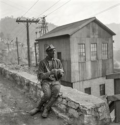 """Coal miner waiting for lift home."" Capels, West Virginia, 1938. http://www.shorpy.com/node/21071 Marion Post Wolcott"