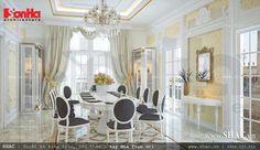Màu ghi của những chiếc ghế chính là điểm nhấn làm phá tan sự đơn điệu của gian phòng ăn kiểu cổ điển Pháp